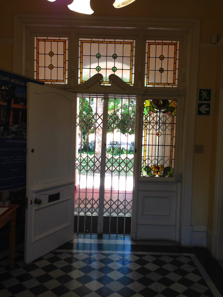 View of stained glass surround to front door from the interior