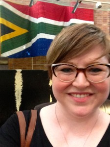 Selfie of the author in front of a hand-beaded South African flag