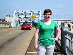 Author in front of the metal arch on the Edmund Pettus Bridge