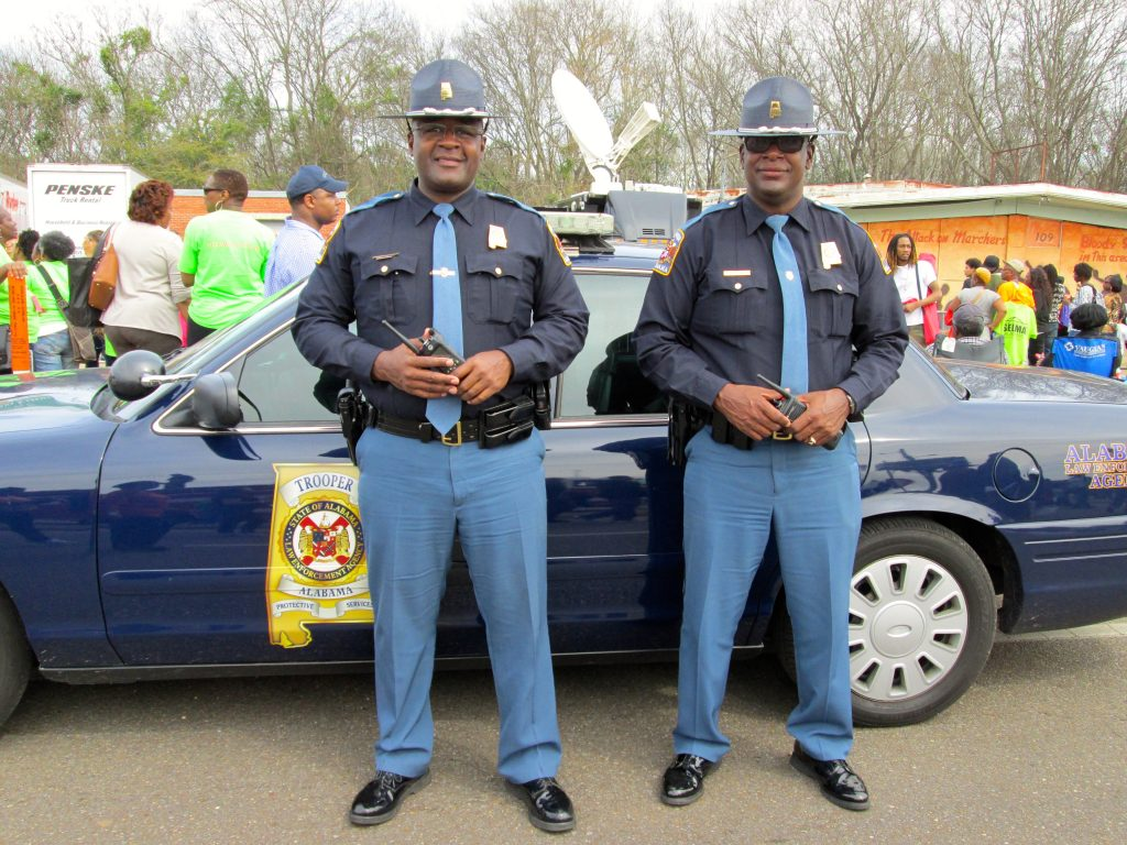 Two Black state troopers on crowd control at the 50th anniversary of Bloody Sunday. (Photo by author)
